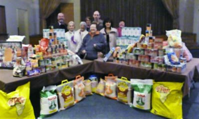 Huge piles of food hampers stacked up in the Beit Emanuel hall